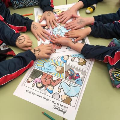manos paz colegio Alcorcón Amanecer